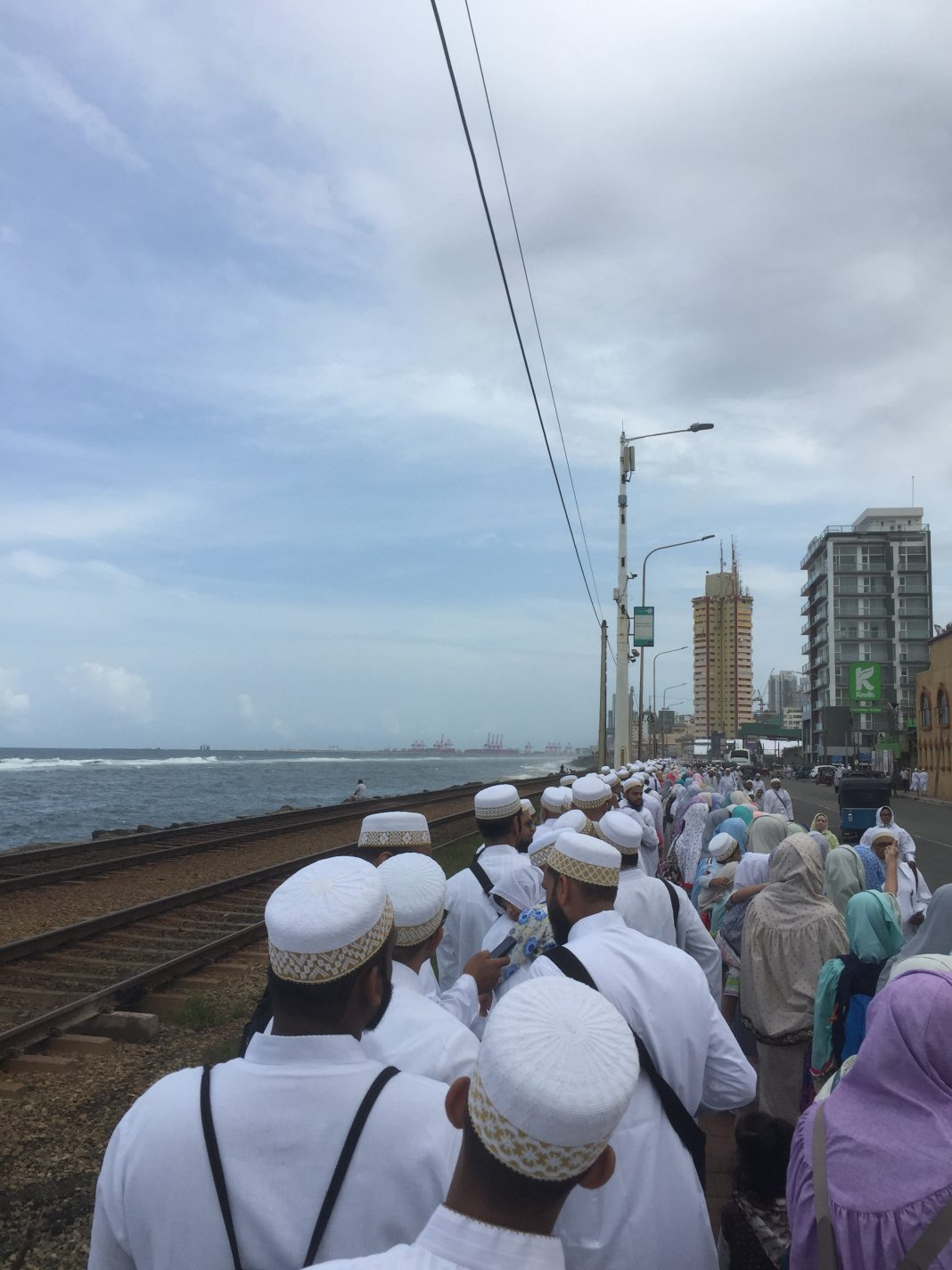 Bohras wait in line for entry to their masjid